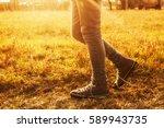 person walking over a grass... | Shutterstock . vector #589943735