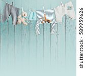 Small photo of Baby clothes hanging on the clothesline