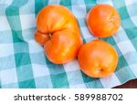 tomatoes on a wooden background | Shutterstock . vector #589988702
