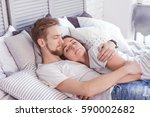 young loving couple in the bed. ... | Shutterstock . vector #590002682