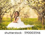 portrait of the bride in ivory... | Shutterstock . vector #590003546
