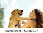 Stock photo girl with her dog resting outdoors 59002267