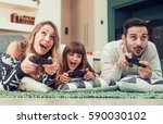 playful family playing video... | Shutterstock . vector #590030102
