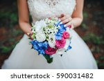 bouquet of flowers in the bride'... | Shutterstock . vector #590031482