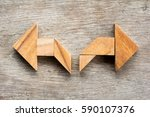 tangram puzzle as two way arrow ... | Shutterstock . vector #590107376