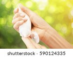 hand hold cream lotion   care...   Shutterstock . vector #590124335