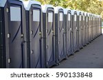 row of portable toilets on a... | Shutterstock . vector #590133848
