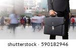 businessman holding a briefcase ... | Shutterstock . vector #590182946