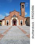 St. Martino bishop romanic church in a sunny day, Carpiano, Milan, Italy - stock photo