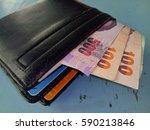 wallet with money in abundance.   Shutterstock . vector #590213846
