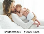 a woman with a baby  | Shutterstock . vector #590217326