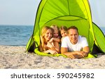 Happy Young Family Camping On...