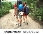 young couple hikers in forest.... | Shutterstock . vector #590271212
