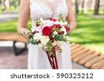 bride holds in her hands... | Shutterstock . vector #590325212