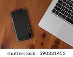 smartphone on wooden table | Shutterstock . vector #590331452