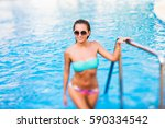 beautiful fit tanned sexy young ... | Shutterstock . vector #590334542