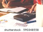 calculator and man doing... | Shutterstock . vector #590348558
