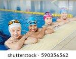 group of joyful boys and girls... | Shutterstock . vector #590356562