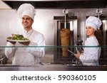 portrait of two smiling chefs... | Shutterstock . vector #590360105