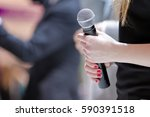 woman stands on stage with... | Shutterstock . vector #590391518