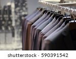 row of men's suits hanging on... | Shutterstock . vector #590391542