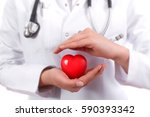 positive female doctor standing ... | Shutterstock . vector #590393342