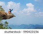 successful woman hiker taking... | Shutterstock . vector #590423156
