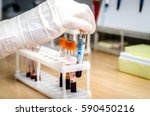 the doctor pulls out the tube...   Shutterstock . vector #590450216