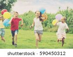 cheerful smiling elementary... | Shutterstock . vector #590450312