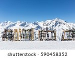 a line of skis and snowboards... | Shutterstock . vector #590458352