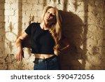 street style. beautiful woman... | Shutterstock . vector #590472056