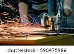 worker man cutting a metal pipe ... | Shutterstock . vector #590475986