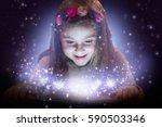 little girl reading magic book  ... | Shutterstock . vector #590503346