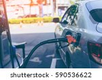pumping gasoline fuel in car at ... | Shutterstock . vector #590536622