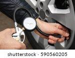Auto Mechanic Checking Tire...