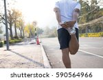 man doing stretching exercise ...   Shutterstock . vector #590564966