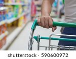man hand close up with shopping ... | Shutterstock . vector #590600972