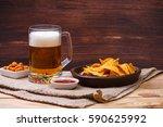 glass of beer. nachos chips.... | Shutterstock . vector #590625992
