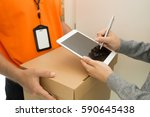 woman appending signature after ... | Shutterstock . vector #590645438