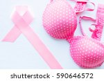 pink ribbon and bra on a white... | Shutterstock . vector #590646572