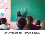 girl resolves mathematical task ... | Shutterstock . vector #590655002
