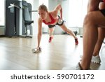 young sporty woman doing push... | Shutterstock . vector #590701172
