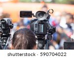 filming an event with a video... | Shutterstock . vector #590704022