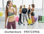 merry young woman in gym | Shutterstock . vector #590723906