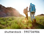 couple traveling in mountains... | Shutterstock . vector #590736986