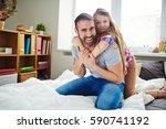 loving family spending time... | Shutterstock . vector #590741192