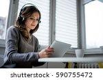 listening favorite music | Shutterstock . vector #590755472
