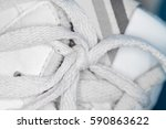 white shoelace knot on white... | Shutterstock . vector #590863622
