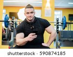 young handsome man using phone... | Shutterstock . vector #590874185