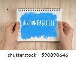 Small photo of Woman holding notebook in hands with words Accountability. Business Concept.
